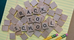 back to school spelled in game tiles