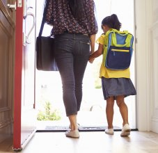 parent and student walking out the door