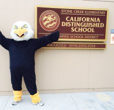 eagle mascot and sign